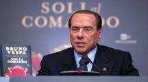 Silvio Berlusconi alla presentazione del libro di Bruno Vespa (foto Ansa)