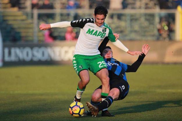 Coppa Italia, Atalanta - Sassuolo: un contrasto di gioco (foto Ansa)