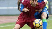 Missiroli cerca di fermare Perotti (foto Ansa)
