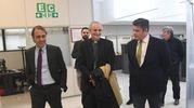 L'arrivo di Monsignor Zuppi al Resto del Carlino (foto Schicchi)