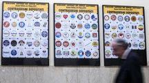 Contrassegni affissi al Viminale per la presentazione dei simboli elettorali (Ansa)