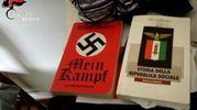 La casa di Traini in un fermo immagine dal video dei carabinieri: trovata anche una copia del Mein Kampf di Hitler