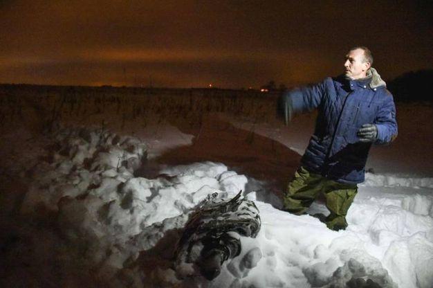 Mosca, proseguono le indagini sull'aereo precipitato (Lapresse)