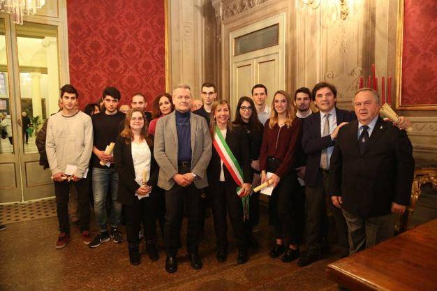 La premiazione dei sei ragazzi vincitori della borsa di studio intitolata a Anita Preghelli (Foto Schicchi)