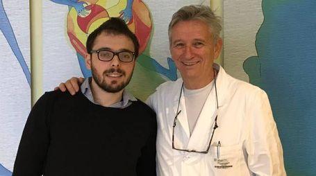 Il giovane Alberto Pinotti e il professor Fabrizio Ferrari