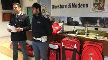 Alcuni gadget trovati a casa del 45enne modenese e posti sotto sequestro (FotoFiocchi)