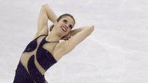 Carolina Kostner durante la gara di pattinaggio artistico (Ansa)