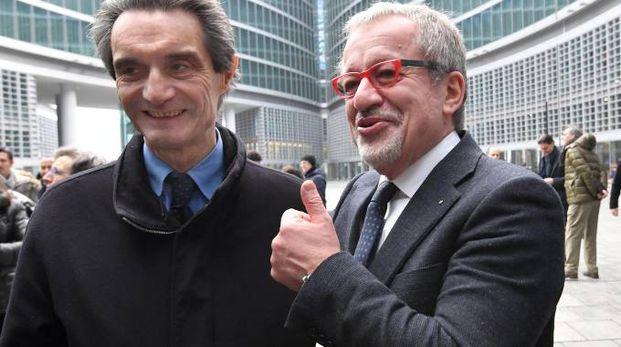 Attilio Fontana e Roberto Maroni (Ansa)