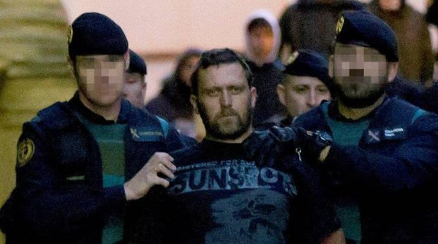 Igor il russo, al secolo Norbert Feher, scortato dalla Guardia Civil spagnola (Foto Ansa)