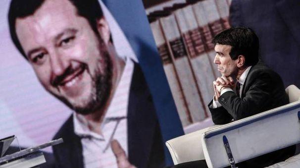 Maurizio Martina a ''Porta a porta''. Dietro, una gigantografia di Salvini (Ansa)