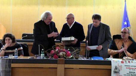 Camilla Palagi, Antonio Ferrari mentre ritira il premio, Umberto Ronchieri, Gianfranco Poma e Andrea Luparia