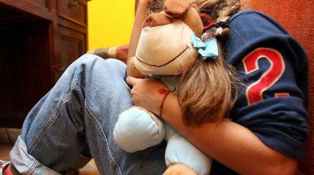 Violenza sui minori (foto di archivio)