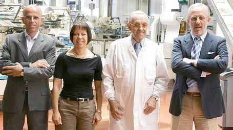 Mario Galbusera coi tre figli nella fabbrica di famiglia di Cosio Valtellino (Orlandi)