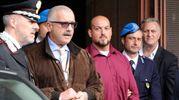 Luca Traini scortato all'uscita dal tribunale (foto Calavita)
