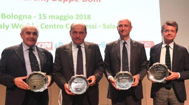 Da sinistra, Beppe Boni, il dg di Bper Banca, Fabrizio Togni, Stefano Palmieri di Granarolo e Andrea Segrè di Caab