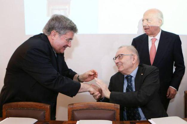 Monsignor Gianantonio Borgonovo saluta Giorgio Squinzi