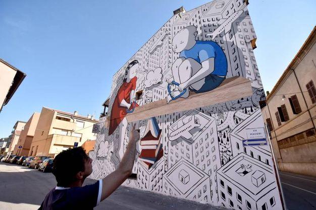 Il muro dipinto da Millo in Piazza del Carmine (foto Fantini)
