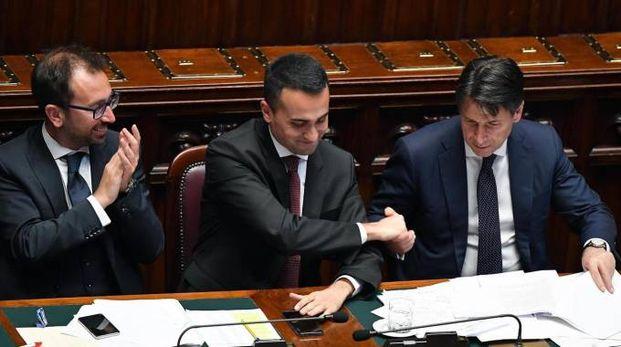 Giuseppe Conte a Montecitorio con Luigi Di Maio e Alfonso Bonafede (Ansa)