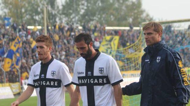 Luca Cacioli con mister Apolloni, ai tempi del Parma (Foto Montefusco)
