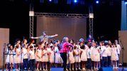Ad aprire le danze è stato, il Piccolo Coro Mariele Ventre dell'Antoniano diretto da Sabrina Simoni, con un medley delle canzoni che hanno fatto la storia dello Zecchino d'oro : il Coccodrillo come fa, il caffè della Peppina, le tagliatelle di nonna Pina per finire con 44 gatti del 1968, interpretata anche dalla band (Foto Schicchi)
