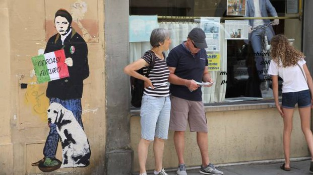 Il murales che ritrae Renzi in via Sant'Agostino (New Press Photo)