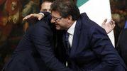 Giorgetti abbraccia Nicola Molteni (Ansa)