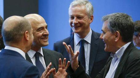 Il ministro tedesco Scholz, Moscovici, il francese Le Maire e il greco Tsakalotos (Ansa)