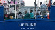 Migranti soccorsi a bordo della Lifeline (Ansa)