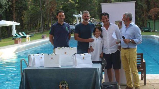 Niccolò Trentanove con il giovane figlio Oliver premiati nel Porsche Autoin Golf Trophy