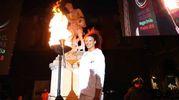 La pallavolista Valentina Diouff ha acceso la fiaccola d'inizio della sesta edizione dei giochi del tricolore dedicato quest'anno a Nelson Mandela che il 18 luglio avrebbe compiuto 100 anni (Foto Artioli)