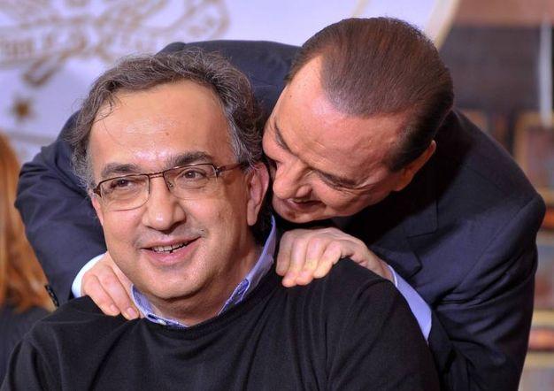 Sergio Marchionne con Silvio Berlusconi (Imagoeconomia)