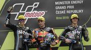 Luca Marini, Miguel Oliveira e Francesco Bagnaia sul podio, rispettivamente secondo, primo e terzo classificato (Foto Ansa)