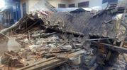 Case distrutte nel villaggio di Batuyang (Lapresse)