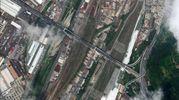Un'immagine satellitare del ponte Morandi crollato a Genova (Ansa)