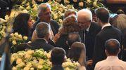 L'abbraccio di Mattarella ai parenti delle vittime (Ansa)