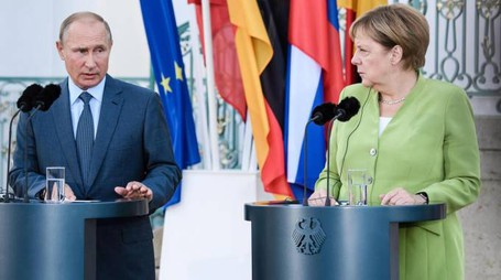 Vladimir Putin e Angela Merkel (Epa)