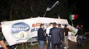Striscione esposto da un gruppo  di esponenti  di Fratelli d'Italia davanti al centro 'Mondo Migliore' (Ansa)