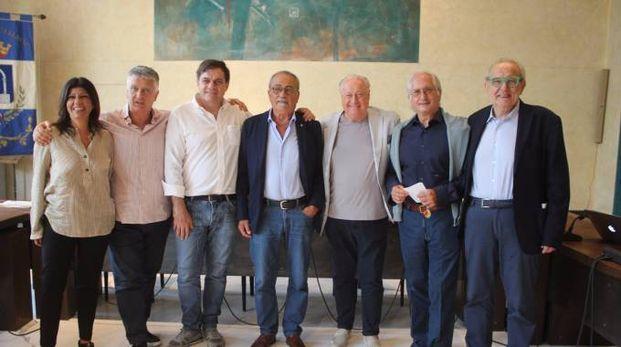 Il presidente Benedetti (al centro) con i membri del Cda