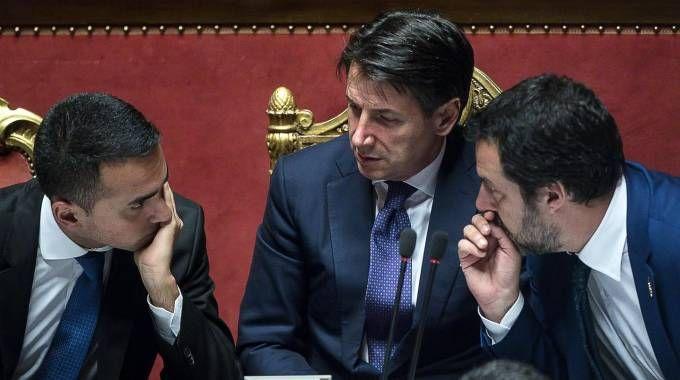 Il premier Conte con i suoi vice Di Maio e Salvini (Ansa)