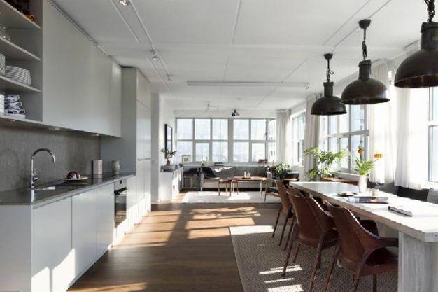 soggiorno open space con cucina a vista