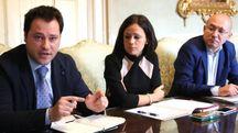 Da sinistra: Marco Bertuzzi, Ina Dhimgjini e Giuliano Palagi durante la conferenza stampa. In alto, Marchetti