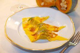 Tortelli di zucca in salsa all'arancia ed erba Luisa