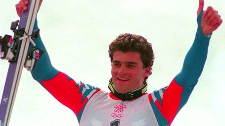 Alberto Tomba esulta dopo avere vinto l'oro nello slalom gigante di Calgary (AFP)