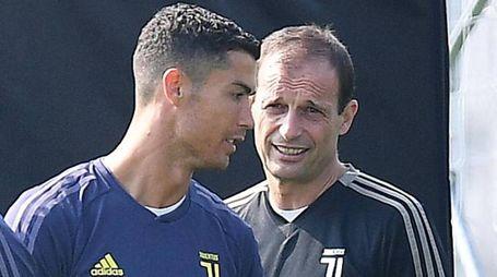 Cristiano Ronaldo con il tecnico Allegri (Ansa)